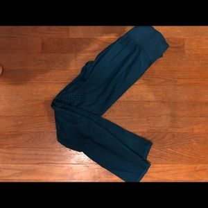 Dark teal workout pants with exposed pattern